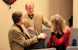 Dad and Mom talking with Pastor Anderson before we sang at our home church for Christmas Eve.