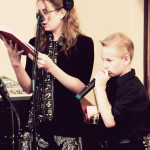 Leesha and Caleb singing a hymn.